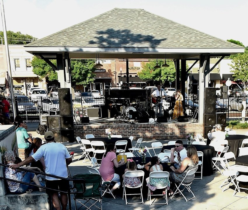 David Lieving and Amy Willingham perform at a previous Music by the Tracks in downtown Cartersville's Friendship Plaza on May 18.