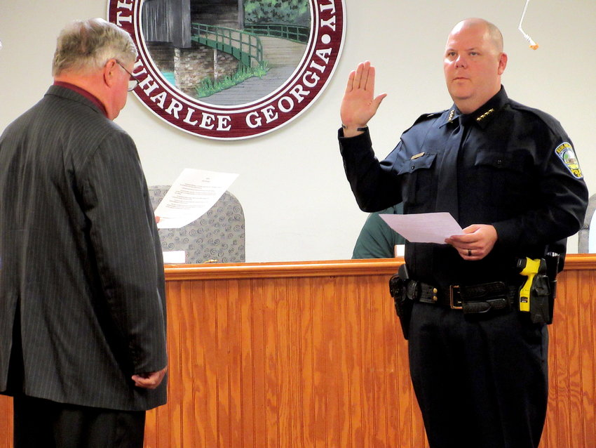 From left, Euharlee Mayor Steve Worthington swears in Jody Matthews as the City's new police chief at Tuesday evening's work session.