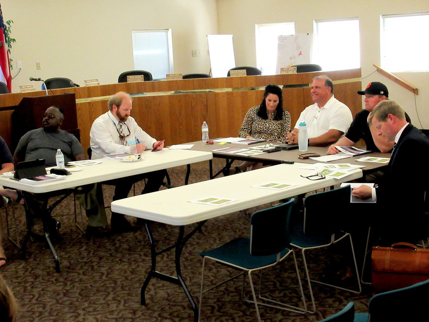 The Cartersville City Council irons out the FY 2020 budget at a work session last month.