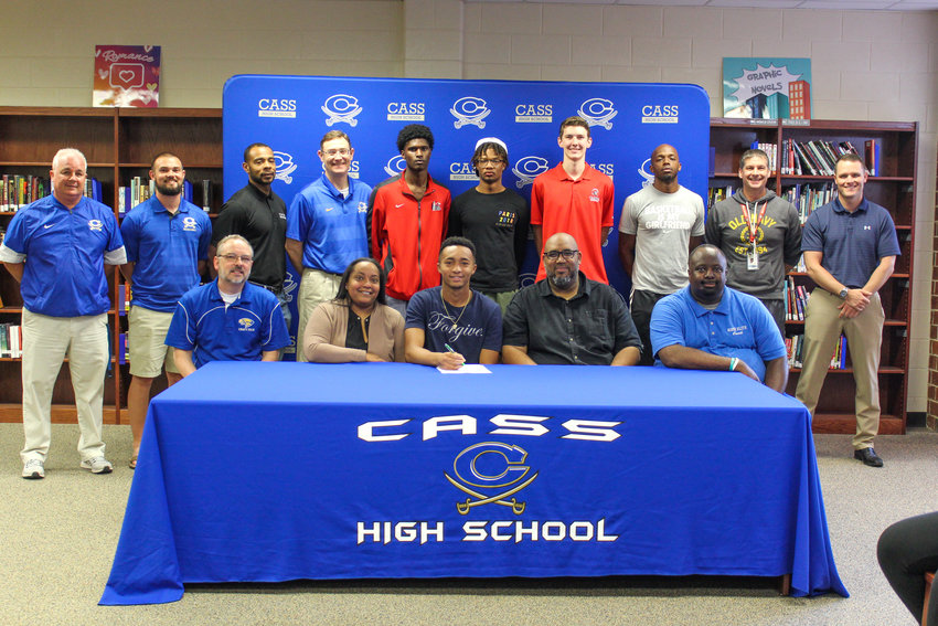 Recent Cass High graduate Justice Hayes signed to play basketball at Toccoa Falls. On hand for the signing were, from left, front row: David Archer Jr., Summer Hill postgrad program; Meliza Hayes, mother; Darnell Hayes, father; Michael Atwater, travel ball coach; back row, Nicky Moore, CHS athletic director; Drew McKaig, CHS assistant coach; Jonathan Wallace, CHS assistant coach; Sean Glaze, CHS head boys basketball coach; Jacquez Fountain, CHS teammate; Ethan Carter, CHS teammate; Jacob Harris travel ball teammate; Emmanuel Holloway, trainer; Burt Jackson, CHS head girls basketball coach; and Steve Revard, CHS principal.
