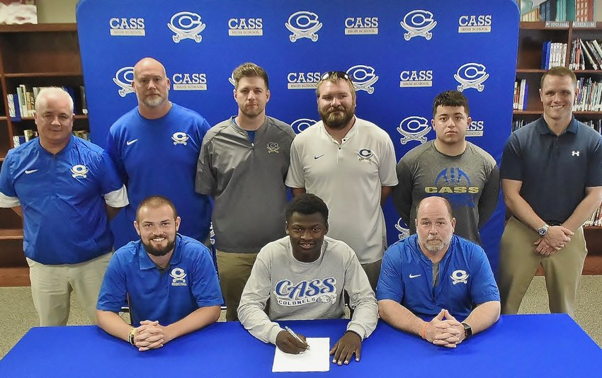 Recent Cass High graduate Javen Bridges signed to play football at Bluffton University in Bluffton, Ohio. On hand for the signing were, from left, front row; Drew McKaig, CHS assistant coach; Bobby Hughes, CHS head football coach; Nicky Moore, CHS athletic director; Jamey Gaddy, CHS assistant coach; P.J. Hughes, CHS assistant coach; Brock Pyle, CHS assistant coach; Christian Yanes, CHS teammate; and Steve Revard, CHS principal.