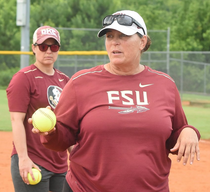 Florida State head coach Lonni Alameda addresses attendees of Wednesday's softball camp at Adairsville High. Former FSU softball player Robin Ahrberg watches in the background.