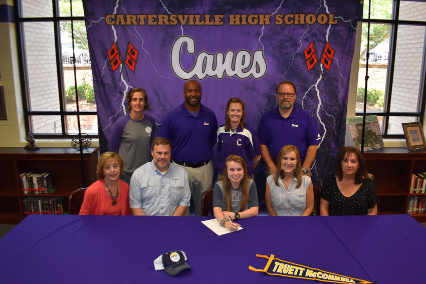 Recent Cartersville High graduate Hannah Rhodes signed to join the women's golf team at Truett McConnell. On hand for the signing ceremony were, from left, front row: Daneise Archer, grandmother; John Rhodes, father; Rebecca Rhodes, mother; Donna Anderson, grandmother; back row, Shelley Tierce, CHS principal; Reggie Perkins, CHS head golf coach; Megan Boudrie, CHS assistant golf coach; and Darrell Demastus, CHS athletic director.