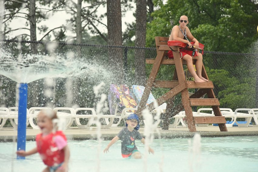 Seen here watching swimmers at the Dellinger Park Pool, Bryson Rogers, a 2019 graduate of Cartersville High School and rising freshman at Kennesaw State University, serves as a lifeguard for the second consecutive year for the Cartersville Parks and Recreation Department.