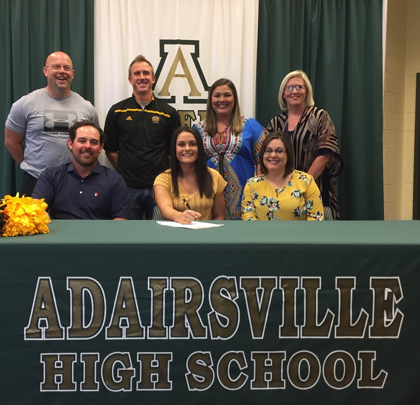 Adairsville High's Ashtyn Edenfield, center, signed to cheer at Kennesaw State University. Also pictured are, from left, front row, J.T. Edenfield, father; Katie Szweda, mother; back row, Dan Szweda, cheer coach and stepfather; Charlie Asciutto, KSU Cheer Coach; Kaylie Noe, AHS Cheer Coach; and Amber Benefield, AHS assistant cheer coach.