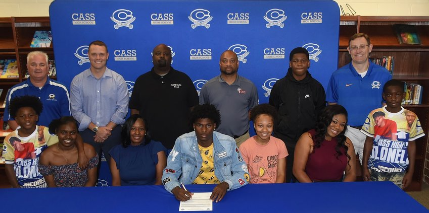 Recent Cass High graduate Jacquez Fountain signed to play basketball at Albany Tech. On hand for the signing ceremony in the CHS Media Center were, from left, front row: Micah Davison, brother; Jamara Fountain, sister; Christian Simmons, mother; Sharia Wade, girlfriend; Natasha Fountain, stepmother; Mykell Davison, brother; back row, Nicky Moore, CHS athletic director; Stephen Revard, CHS principal; Michael Atwater, travel ball coach; Sylvester Patterson, Albany Tech head men's basketball coach; Rahkeem Jackson, stepbrother; and Sean Glaze, CHS head boys basketball coach.