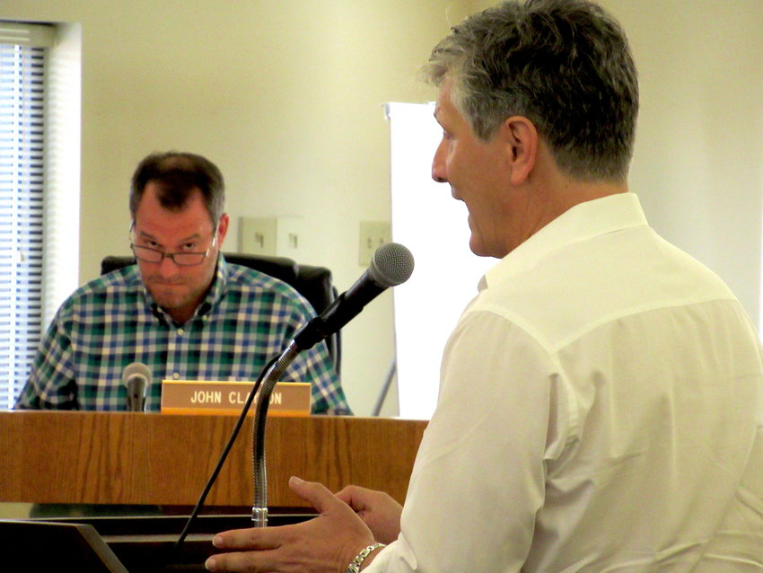 Steven Delonga, a representative for a developer seeking to construct about 200 townhomes on the previous Etowah Preserve property, speaks at Monday evening's Cartersville Board of Zoning Appeals meeting.