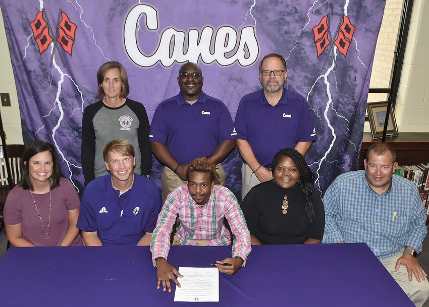 Recent Cartersville High graduate Sunni Moorehead signed to played football at Concordia University in Seward, Nebraska. On hand for the signing ceremony were, from left, front row: Kim Foster, teacher; Conor Foster, CHS head football coach; Letitia Moorehead, mother; Dan Shabo, community mentor; back row, Shelley Tierce, CHS principal; Cedric Ward, CHS assistant football coach; and Darrell Demastus, CHS athletic director.