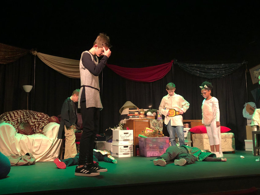 """Nick Smith, front, and his fellow Pumphouse Junior members rehearse a scene from """"Brave Little Tailor."""""""