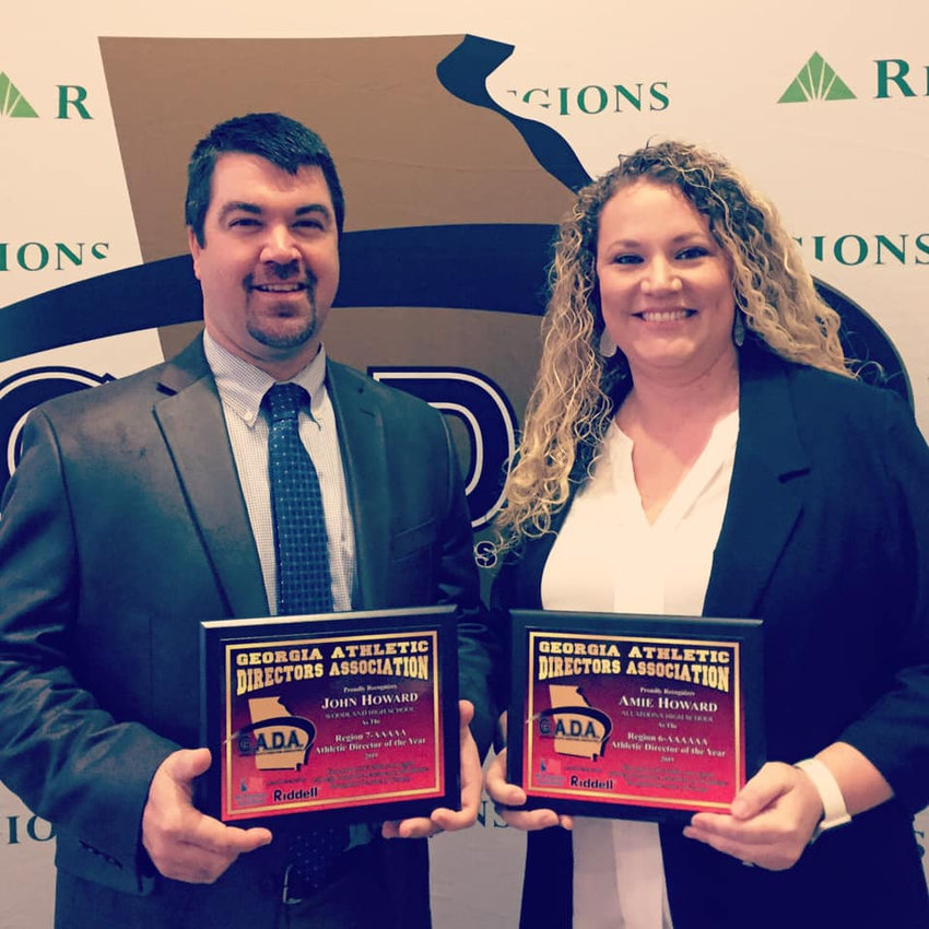 Woodland athletic director John Howard, left, and Allatoona athletic director Amie Howard show off their respective region AD of the year awards for 2018-19 at the Georgia Athletic Directors Association's annual conference March 25 in Savannah.