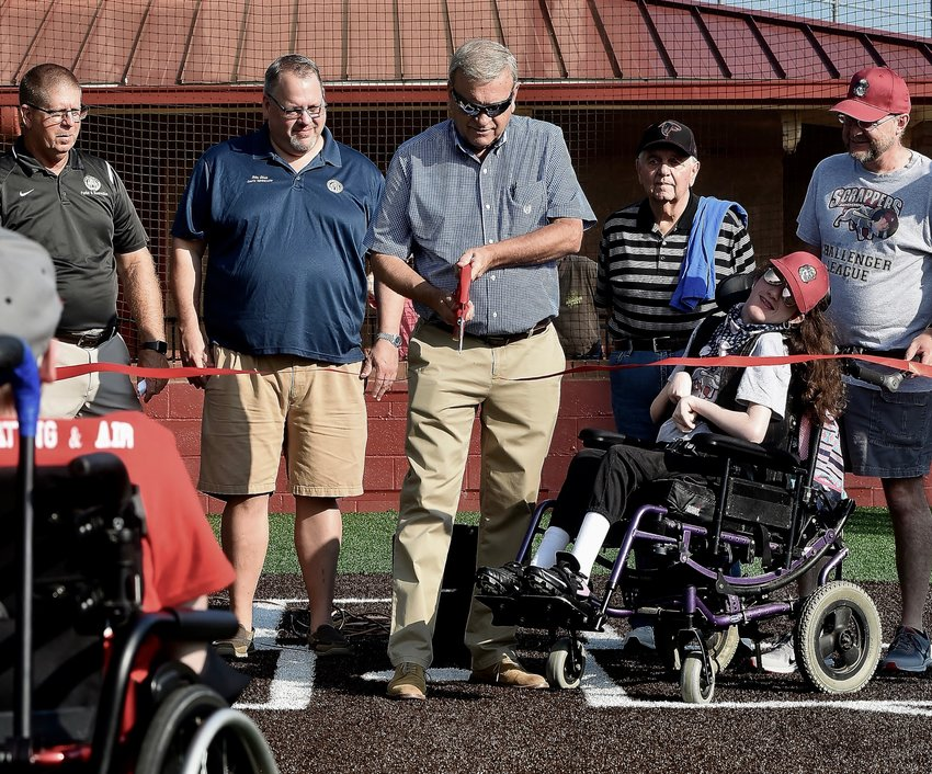 Hundreds were on hands Saturday morning at Hamilton Crossing as Bartow County Commissioner Steve Taylor cut the ribbon to officially open the county's new special needs field. The field will be used for sports such as baseball, softball, and soccer.