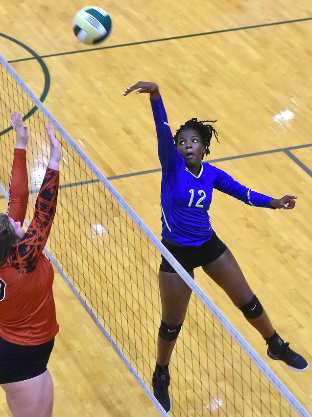 Cass sophomore Kya Perkinson connects on a shot against Sonoraville in the quarterfinals of the Welcome to the Jungle tournament Saturday at Adairsville. The Colonels won the match 25-21, 25-17 and finished 2-3 on the day.