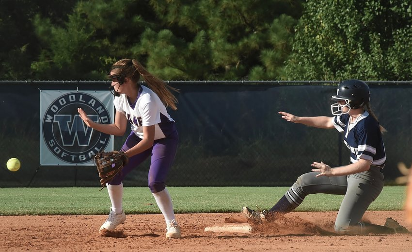 Woodland senior Allyssa Motes slides safely into second base ahead of a throw to Cartersville senior Hope Short during a non-region game Aug. 15. The Canes and Wildcats will likely meet in region play during the 2020-21 and 2021-22 school years after the GHSA announced Cartersville would be bumped up to Class 5A during the next reclassification cycle.
