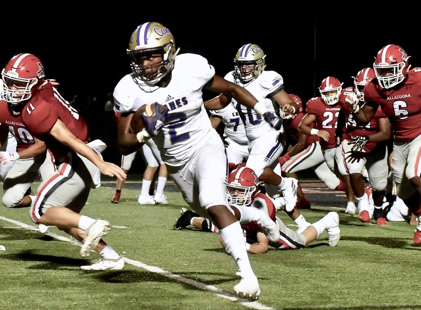 Cartersville junior running back Quante Jennings breaks away from the Allatoona defense on his way to a 98-yard touchdown run Friday night in Acworth.