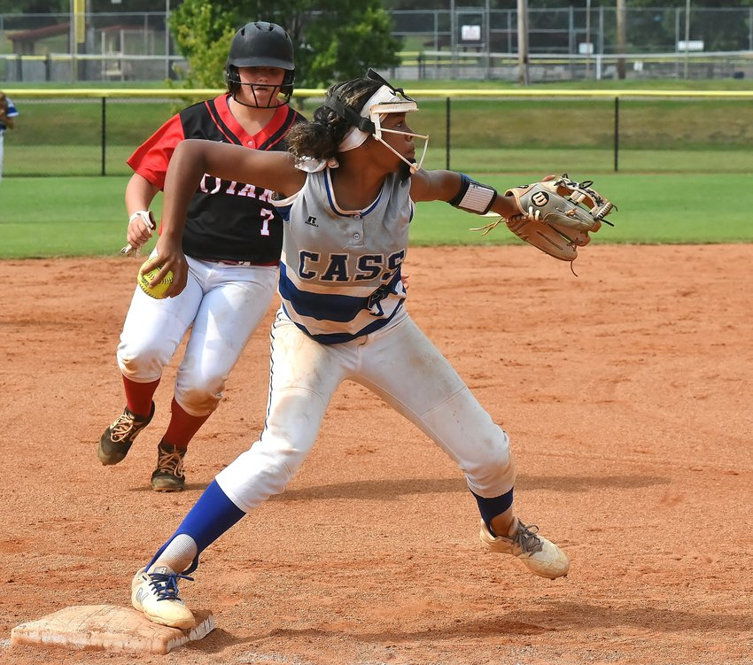 Cass freshman Alexis Woods records an out at third base before throwing late to first base on an attempted double play against North Oconee Saturday at Hamilton Crossing.