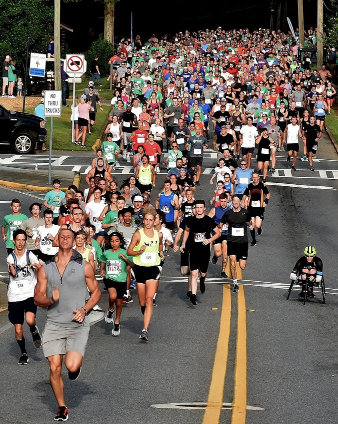 """More than 1,150 people signed up for this year's Downtown Cartersville 5K, starting at the intersection of Church and Bartow Streets and finishing in Friendship Plaza in downtown Cartersville. The event raised approximately $34,000 for BackPack Buddies, which provides """"children in Cartersville City and Bartow County schools from food-insecure homes with weekend meals during the school year,"""" according to its website."""