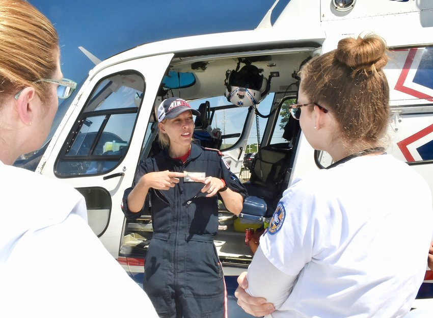 AirLife Georgia Flight Nurse Amy Merritt discusses airlifting patients with nursing students from Reinhardt University at Cartersville Medical Center's helipad on Thursday.