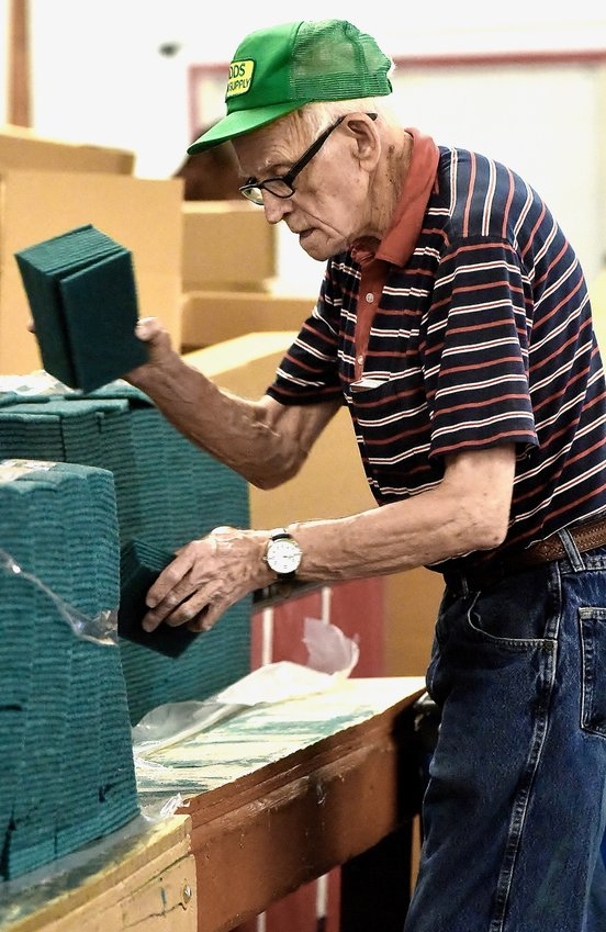 Good Shepherd Foundation client John Emmitt packs cleaning sponges for Americo Manufacturing, one of GSF's accounts.