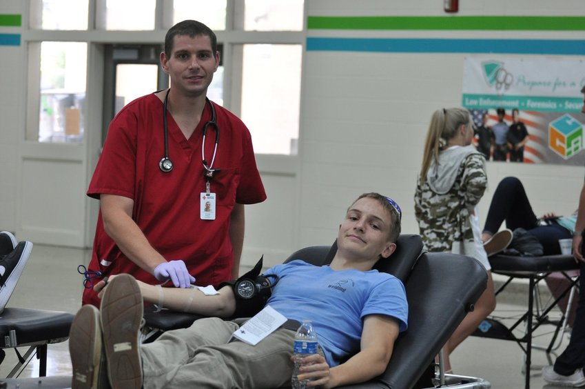 Red Cross staff member Michael Wright, left, monitors Harrison Lupold, who graduated last year from the welding program at the Bartow County College and Career Academy, as he gives blood at last week's BCCCA blood drive.