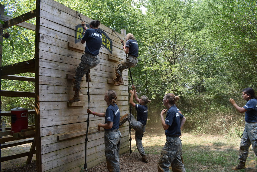 Adairsville High School JROTC Raiders, left to right from top, freshman Georgia Conduff, sophomore Ashlynn Waters, senior Mallory Woodall, sophomore Kaylie Hilburn and sophomore Melody Cress climb the 12-foot wall during the Obstacle Course at Saturday's Adairsville Raider Rampage.