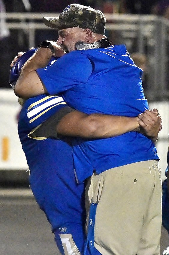 Cass head football coach Bobby Hughes celebrates with a player following a win over Villa Rica on Sept. 20. Hughes will not return as head coach next season after accepting a newly created position within the school's athletic department.