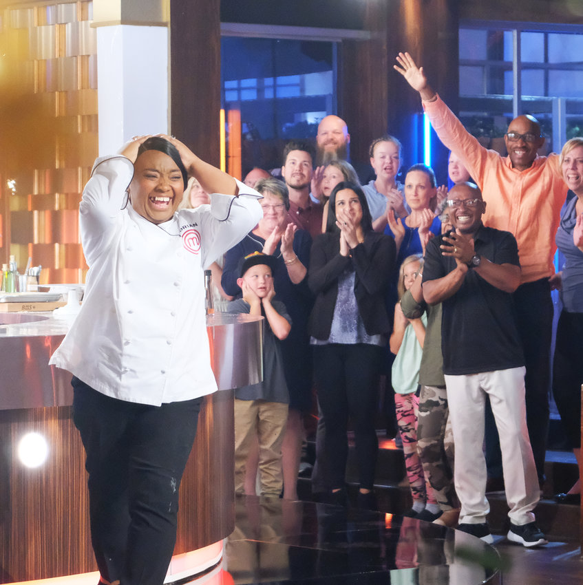 "Dorian Hunter celebrates after winning the ""MasterChef"" title."