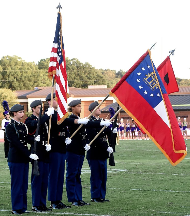Members of the new JROTC program at Cartersville High School present the colors at the school's first home football game Aug. 30. They are, from left, Theresa Leiblang, Dalton Ross, Tristan Martin, Adrienne Coleman and Cameron Allen.