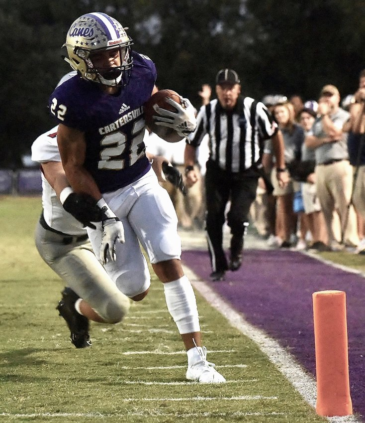 Cartersville junior Sam Phillips scores the Canes' first touchdown in a 24-2 win over Cedartown on Friday at Weinman Stadium. Phillips finished with six catches for 72 yards, including the 18-yard score.