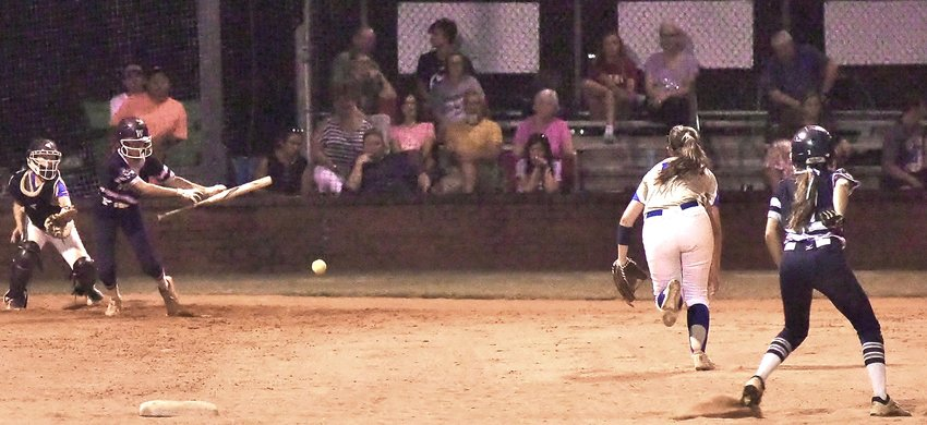 Woodland's Morgan Bailey lays down a bunt to advance teammate Bella Carnes from first base during Tuesday's Region 7-AAAAA tournament game against Cass at Woodland. The Wildcats won the game by a 10-2 final score.