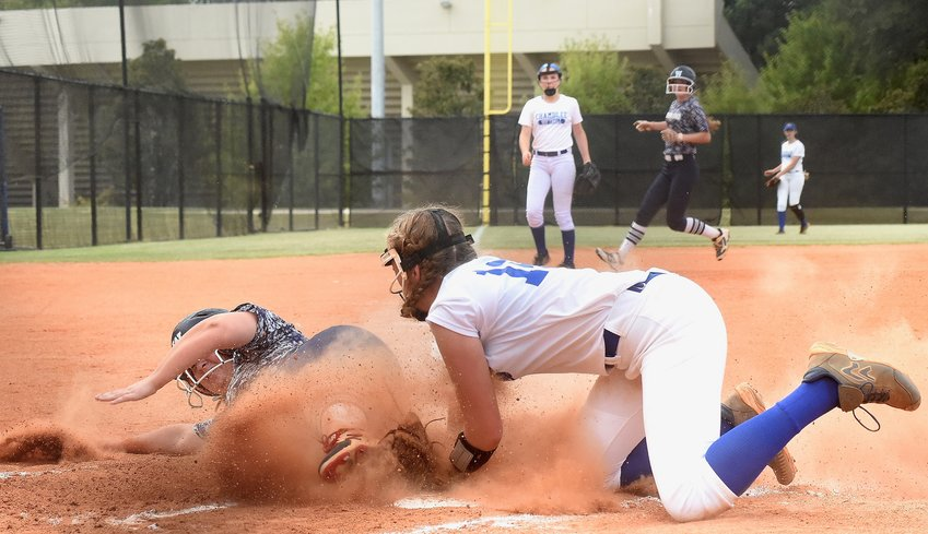 Woodland junior Kendyl Hardin scores on a passed ball for the Wildcats' second run of a 2-1 win over Chamblee in Game 1 of a Class 5A state playoffs first-round series Tuesday in DeKalb County.