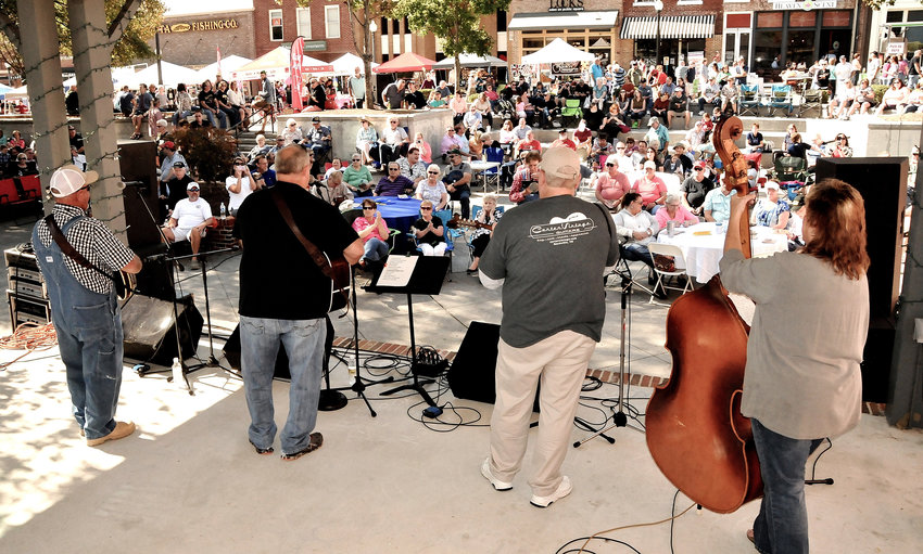 The Old Mill Road Band performs on the Depot Stage at the Cartersville bluegrass festival.