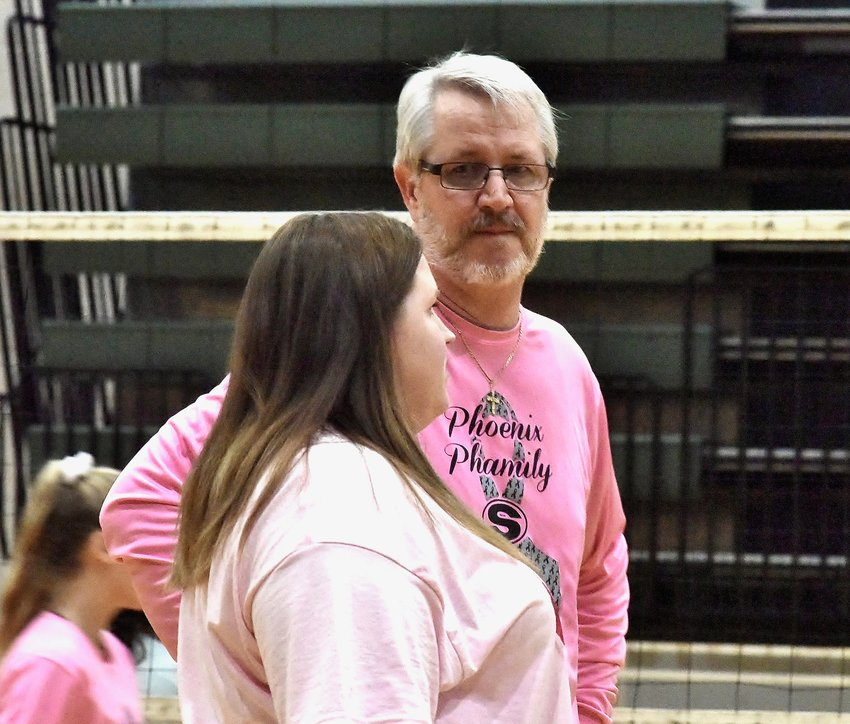 "Adairsville volleyball coach Kailey Vaughn Martin talks with her father and Sonoraville coach Trace Vaughn Oct. 1 inside the Tigers' gym. Adairsville hosted a ""Pink Out"" event that night to Melanie Vaughn — Kailey's mother and Trace's wife — who died in April after a three-year battle with breast cancer."