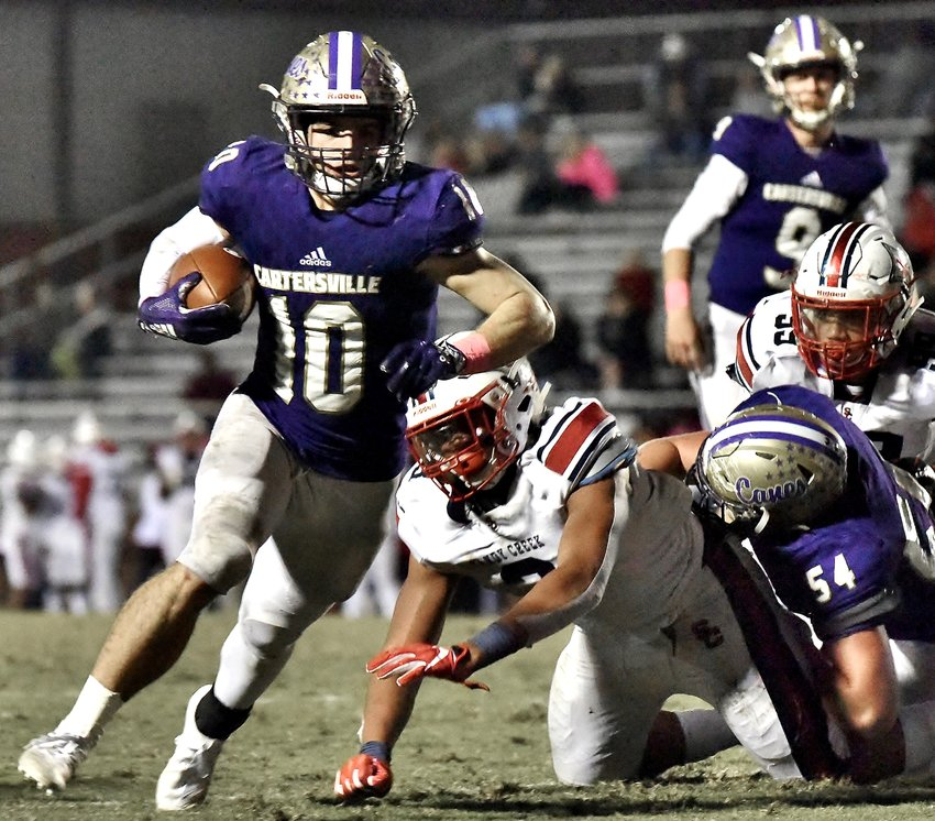 Cartersville junior running back Harrison Allen scores on a 2-yard touchdown to help give the Canes a 24-point lead against Sandy Creek Friday at Weinman Stadium. The Canes held on for a 52-42 win with Allen posting 72 yards and two touchdowns on a dozen carries.