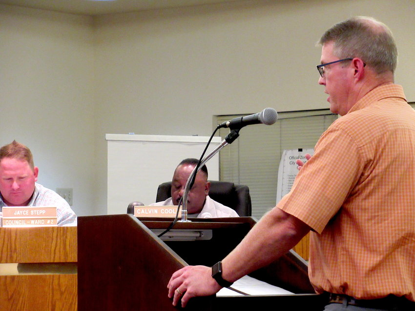 City of Cartersville Water Department Director Bob Jones takes to the podium at Thursday's city council meeting.