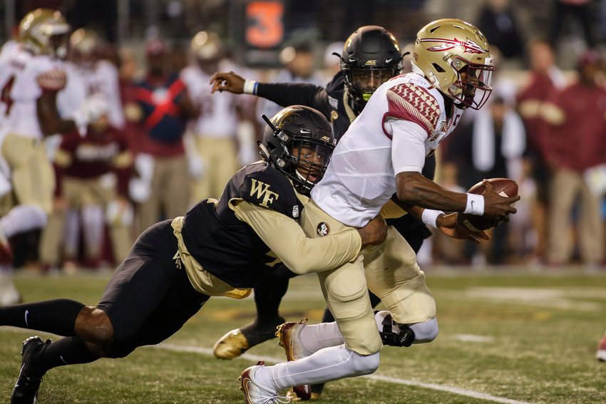 Former Cartersville High and current Wake Forest linebacker JaCorey Johns, left, sacks Florida State quarterback James Blackman in the first half of a game Saturday in Winston-Salem, North Carolina.