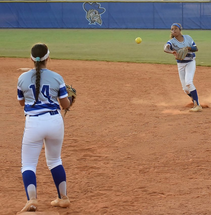 Cass freshman Alexis Woods, right, throws to first baseman Macenzie Dougharty to record an out against Hiram during an Aug. 27 home game. Woods was named DTN Player of the Year.