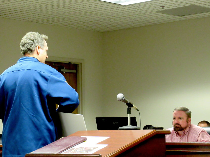 Karl Lutjens shows off designs for a proposed distribution center project off Highway 293 at Monday evening's Bartow County Planning Commission meeting.