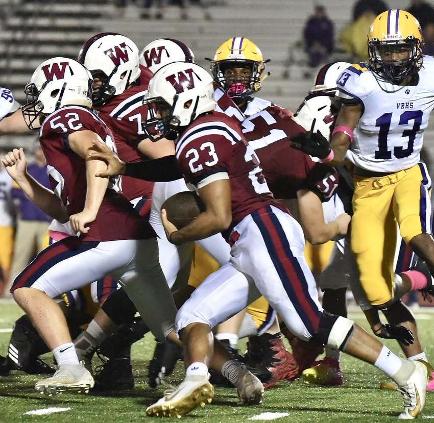 Woodland senior Demarcus Williams follows his blockers as he looks for running room against Villa Rica in an Oct. 25 home game. This week, Woodland will host Kell in the regular-season finale for both teams.