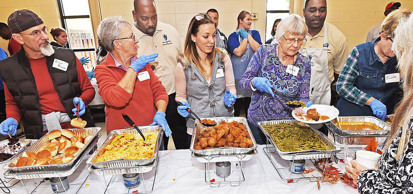 In its 19th year, the Feed the Community Dinner in Honor of Michael Dean is expected to serve about 2,000 people Nov. 23 at the Cartersville Civic Center.