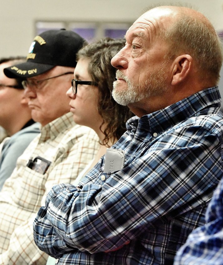 Cartersville Middle School eighth grader Molli Lochridge sits between her grandfathers, Walter Lochridge, left, and Eddie McMicken, at the CMS Veterans Day Celebration Thursday morning in the school's gym Lochridge served in the Army, while McMicken served in the Air Force.
