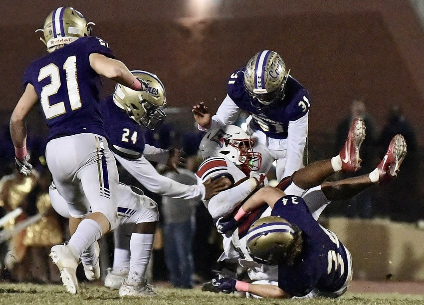 Cartersville defenders converge on a Sandy Creek ballcarrier during a game at Weinman Stadium on Oct. 18. The Canes will take on Flowery Branch today at home in the first round of the Class 4A state tournament.