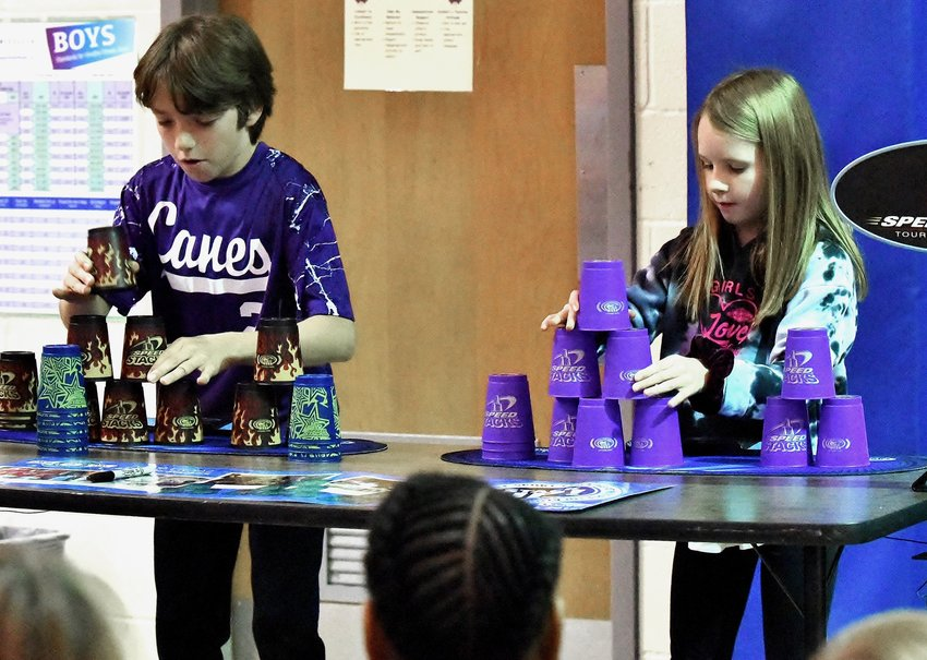 Cartersville Elementary School fourth-graders Blake Genrich and Addison Cochran participate in a cup-stacking race Thursday as part of the school's efforts to help achieve a record for the number of people stacking cups worldwide within a 24-hour period.