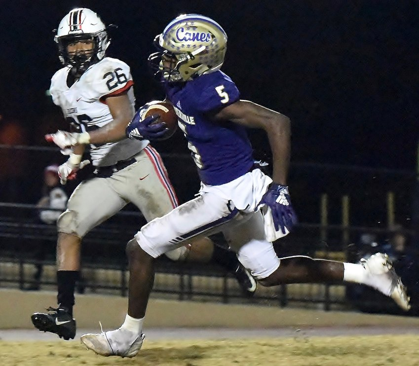 Cartersville junior Devonte Ross outruns a Flowery Branch defender to score a touchdown in a victory Friday night at Weinman Stadium. The touchdown and subsequent extra point gave the game its 14-6 final score.