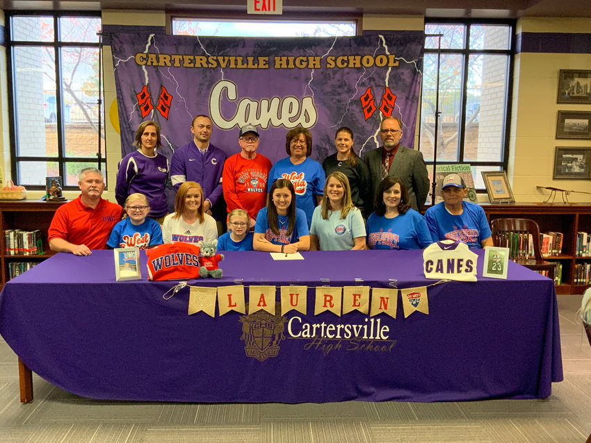 Cartersville High senior Lauren McElhaney signed to play softball at West Georgia in Carrollton Wednesday in the CHS media center. On hand for the ceremony were, from left, front row: Patrick McElhaney, father; Mallory McElhaney, sister; Anna Kate McElhaney, sister; Finley McElhaney, sister; Dawn McElhaney, mother; Cynthia Payne; Don Payne; back row, Shelley Tierce, principal; JoJo Underwood, assistant softball coach; Arthur McElhaney, grandfather; Aileen McElhaney, grandmother; Shannon Suarez, head softball coach; and Darrell Demastus, athletic director.