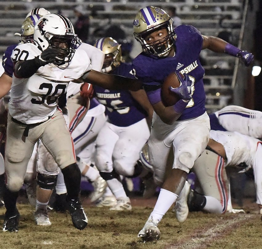 Cartersville junior running back Quante Jennings (2) looks to avoid a Flowery Branch defender during Friday's 14-6 win at Weinman Stadium. The win kicks off what could be a tough path for the Canes in pursuit of a state championship.
