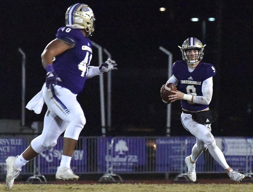 Cartersville senior quarterback Tee Webb (9) looks downfield as sophomore tight end Nasir Grandberry runs a route during Friday's game against Flowery Branch at Weinman Stadium. Webb finished 23-for-36 passing for 281 yards and two touchdowns.