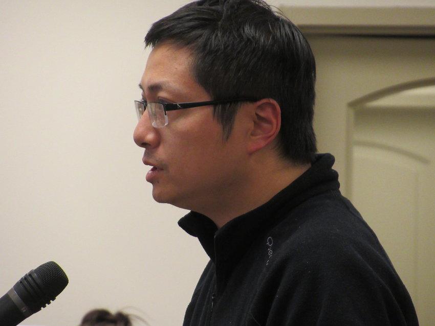 GreenView Floors International Inc. representative Chang Shen speaks at Thursday evening's Adairsville City Council meeting.