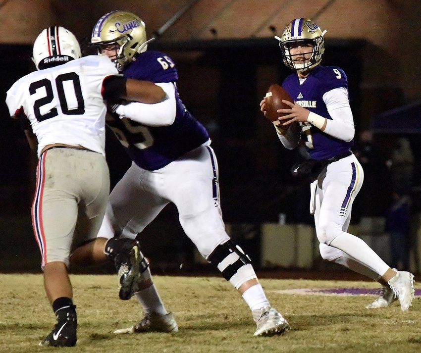 Cartersville senior quarterback Tee Webb scans the field while right tackle Jonah Gambill protects during last week's Round 1 game against Flowery Branch at Weinman Stadium. Friday, the Canes will look to advance further in the playoffs with a game against Thomson back at Weinman.