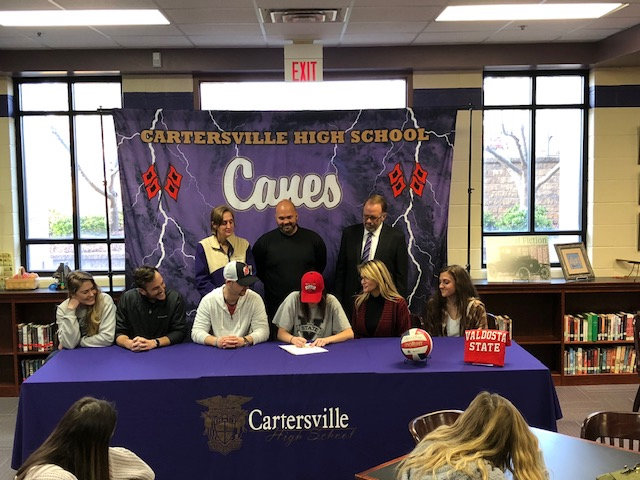 Cartersville High senior Lauren Wenzell signed to play volleyball at Valdosta State during a ceremony Monday in the CHS media center. On hand for the signing were, from left, front row: Andie Kieser, Brandon Wafrock, Peter John Wenzell, Adele Wenzell, Missy Beber; back row, Shelley Tierce, Dutch Cothran and Darrell Demastus.