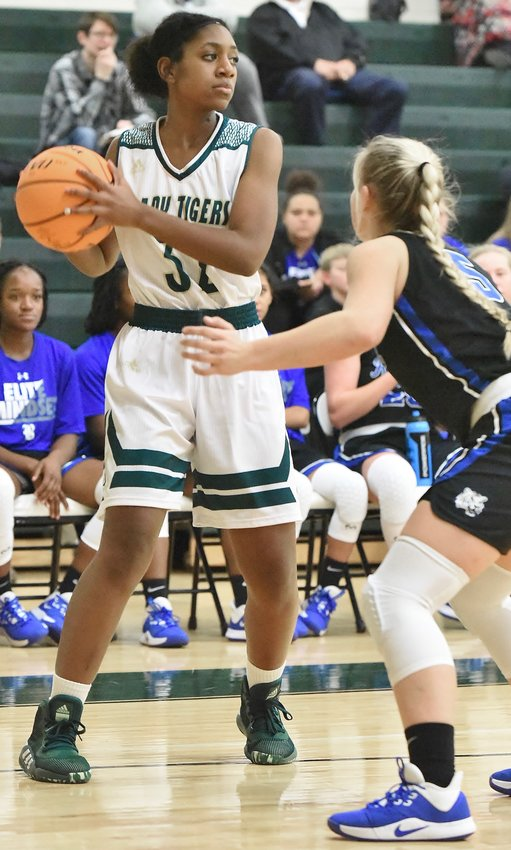 Adairsville sophomore Autumn Henderson is defended by a Ringgold player during Tuesday's game at Adairsville Middle School.